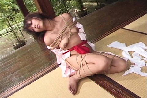 Chinese Restrained In Strap Restrain Bondage Outdoor Via Dom